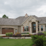 2 Story with stone arch, transom entrance and cedar shake roof - Anthony Thomas Builders