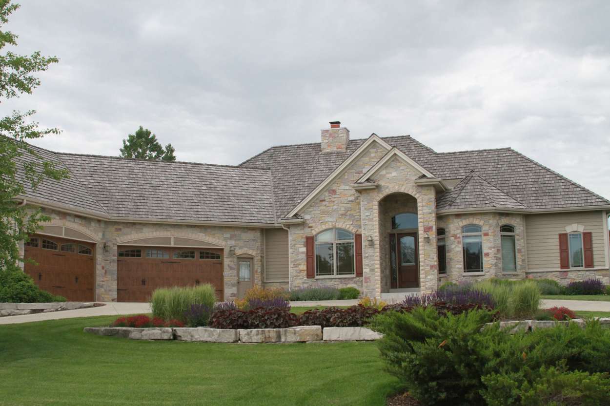 2 story with stone arch transom entrance and cedar shake for Roof height of 2 story house
