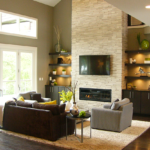 Great room with stone fireplace. folding window doors - Anthony Thomas Builders