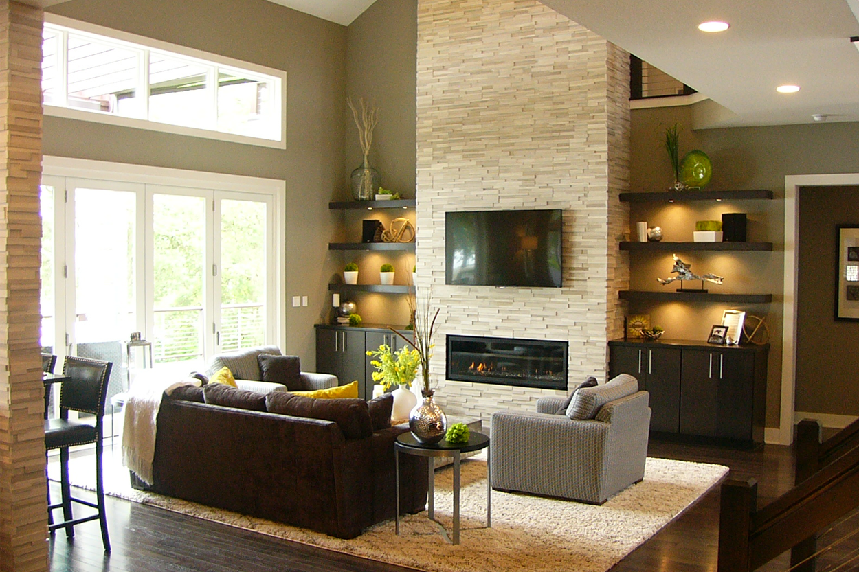 Great room with stone fireplace folding window doors for Great room fireplace