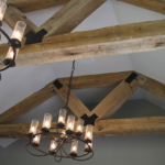 Great Room - Dinette raised ceiling with barn beam trusts and black iron lighting - Anthony Thomas Builders