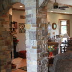 Foyer entrance with stone columns and arches - Anthony Thomas Builders