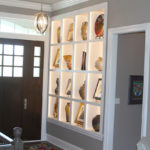 Foyer with art display backlight wall - Anthony Thomas Builders