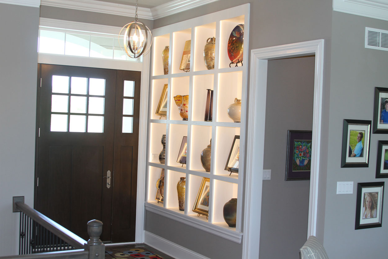Art For Foyer : Foyer with art display backlight wall anthony thomas builders