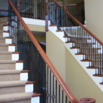 Foyer with wrought iron double staircase and balcony - Anthony Thomas Builders