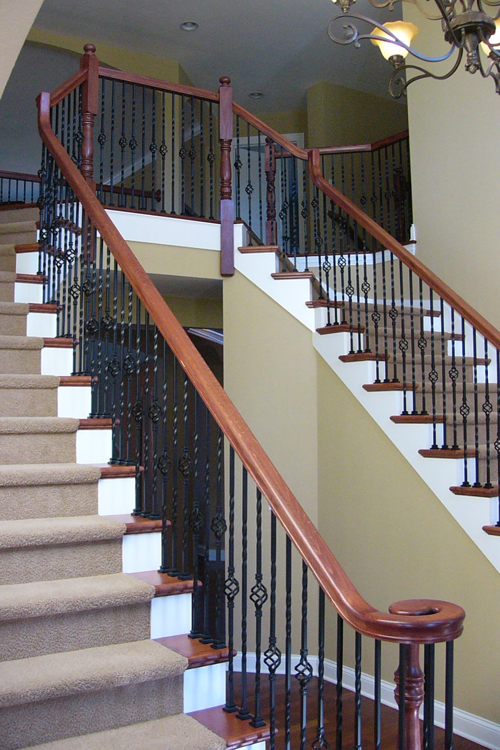 Foyer Stairs Review : Foyer with wrought iron double staircase and balcony