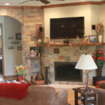 Great Room - Rustic stone fireplace with mantle and stone arch - Anthony Thomas Builders
