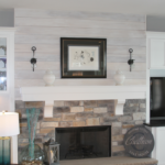 Great room with shiplap and stone fireplace - Anthony Thomas Builders