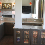 Great Room - Bar with columns and glass display cabinets and raised countertops - Anthony Thomas Builders
