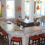 Home bar with stacked stone, front glass cabinets and granite countertops - Anthony Thomas Builders