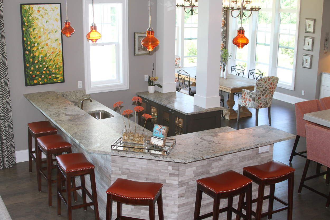 Home bar with stacked stone, front glass cabinets and granite ...