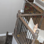 Foyer - Iron railing with custom newel posts - Anthony Thomas Builders