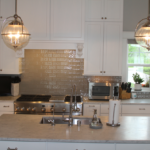 Kitchen with two islands and pendant lighting - Anthony Thomas Builders