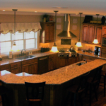 Kitchen with double oven, sink and granite countertops - Anthony Thomas Builders