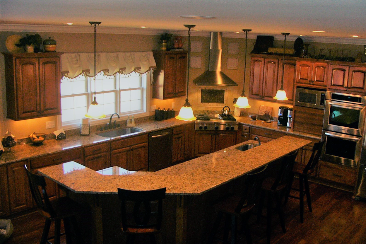 Kitchen with double oven, sink and granite countertops ...