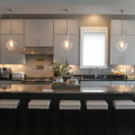 Kitchen with granite island and pendant lighting - Anthony Thomas Builders