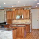 Kitchen with open concept, island and brick back splash - Anthony Thomas Builders