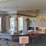 Great Room - Open concept with coffered ceiling and stacked stone bar - Anthony Thomas Builders