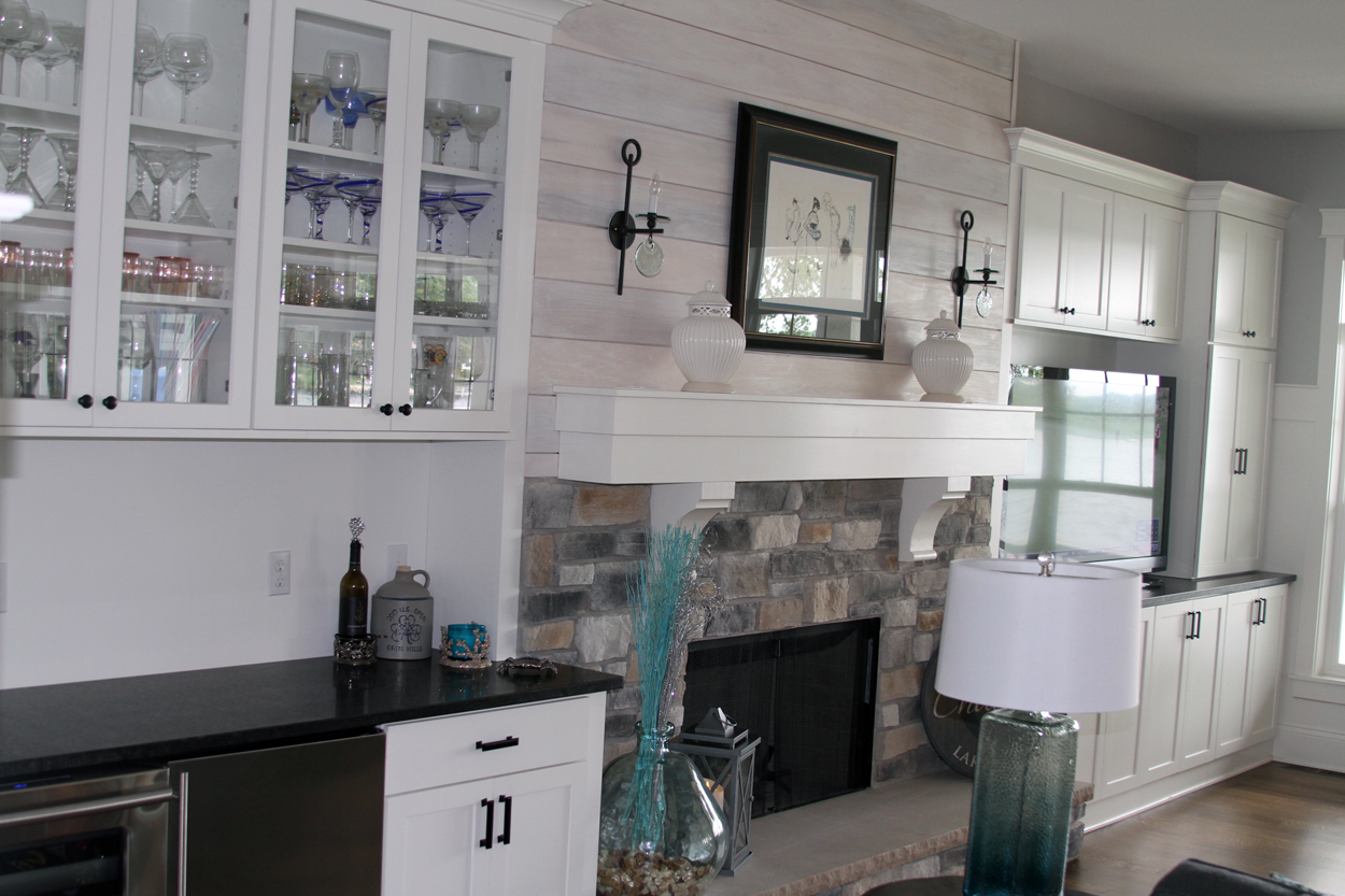 Great toom with home bar, stone fireplace shiplap - Anthony Thomas ...