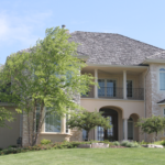 2 Story home with stone front and iron railings - Anthony Thomas Builders