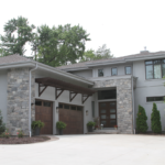 2 Story stone lake home - Anthony Thomas Builders