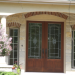 2 Story home with custom wood front door - Anthony Thomas Builders
