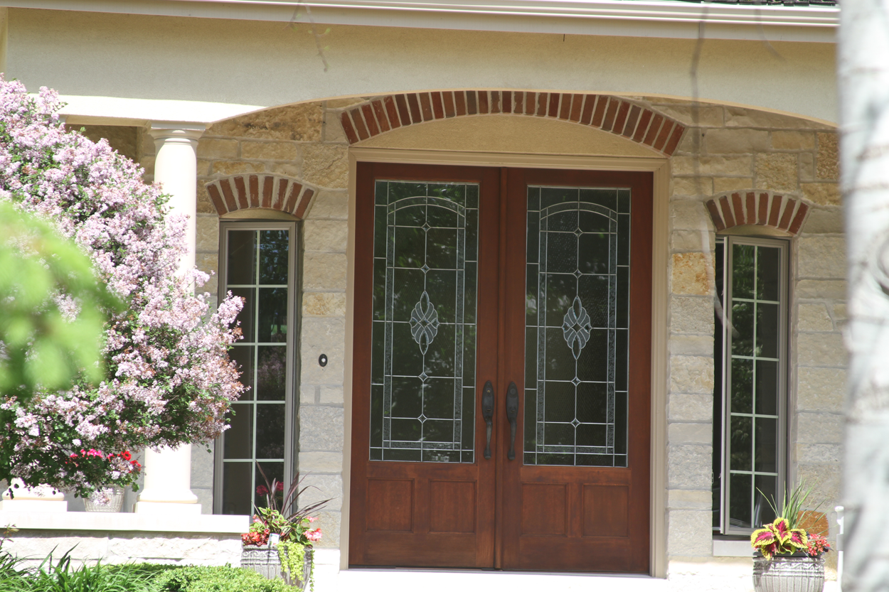 2 Story home with custom wood front door - Anthony Thomas Builders & 2 Story Homes by Anthony Thomas Builders