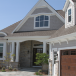 Ranch home with square columns, elliptical window and shake siding - Anthony Thomas Builders