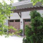 2 Story stone lake home garage doors - Anthony Thomas Builders