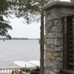 2 Story lake home with stone column and cable railing - Anthony Thomas Builders