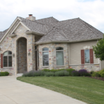 Ranch home prairie style with cedar shake roof - Anthony Thomas Builders