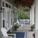 Sitting porch with ceiling fan and stained wood ceiling - Anthony Thomas Builders