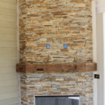 Exterior stone veneer fireplace dry stacked and screen - Anthony Thomas Builders