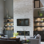 Stone fireplace with built-in shelves - Anthony Thomas Builders