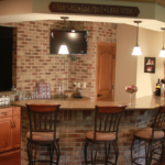 Basement bar with pendant lighting and quartz countertops - Anthony Thomas Builders