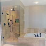 Bathroom with 3 shower head glass door shower - Anthony Thomas Builders