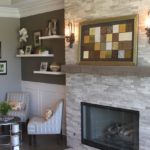 Living Room with stone veneer dry stacked fireplace and mantle with beam - Anthony Thomas Builders