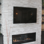 Great room with stone horizontal fireplace - Anthony Thomas Builders
