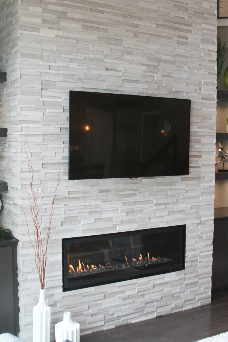 Great Room With Stone Horizontal Fireplace Anthony