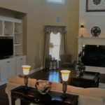 Great Room with built-ins, crown molding and fireplace - Anthony Thomas Builders