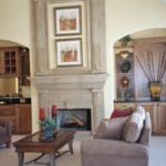 Great Room with vaulted ceilings, arches and precast stone fireplace - Anthony Thomas Builders