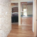 Hallway with interior brick and hardwood floor - Anthony Thomas Builders