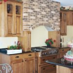 Kitchen with brick hood alcove - Anthony Thomas Builders