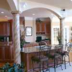 Kitchen with double island, columns and arches - Anthony Thomas Builders