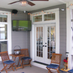3 Season porch with ceiling fan and TV - Anthony Thomas Builders
