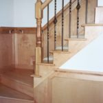 Foyer stairs with wainscoting - Anthony Thomas Builders